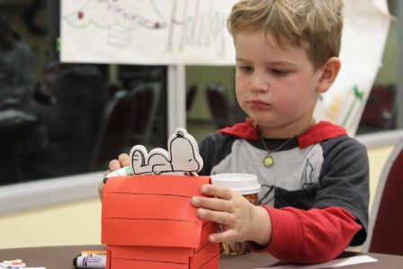Participant making a foam Snoopy house
