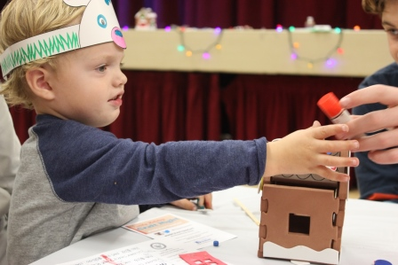 Participant making a foam gingerbread house