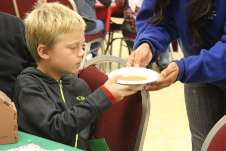 Participant enjoying soup during Crafts Night