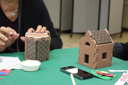 Participants making foam gingerbread houses