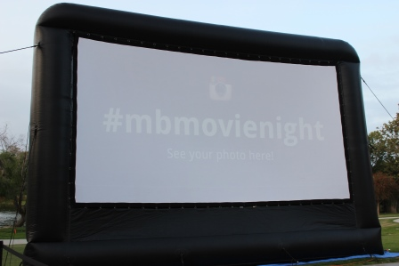 The Movie in the Park hastag, #mbmovienight on the big screen.