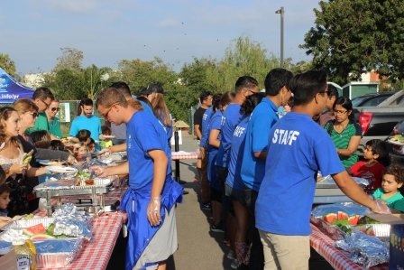 Manhattan Beach Parks and Recreation staff serving dinner to the campers and their families.
