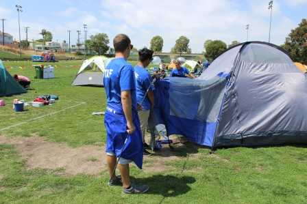 Parks and Recreation Staff setting up tents