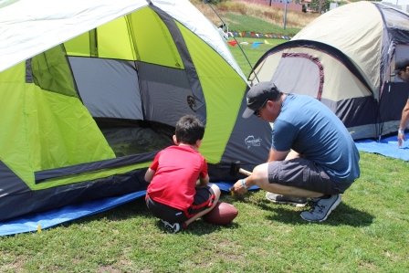Father and son setting up tents