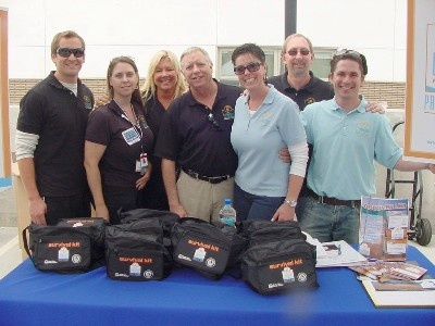 Leadership Manhattan Beach hosts a booth and passes out Envelopes of Life and emergency preparedness supplies