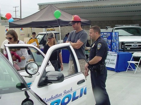 Event attendees take a peak in a patrol car