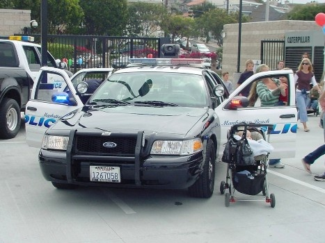 Event attendees climb in a patrol car