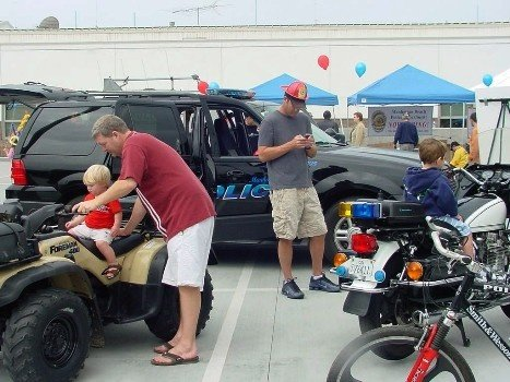 Police Department Vehicle Display includes a patrol car, a beach patrol all-terrain vehicle, and a beach patrol bike