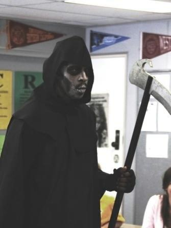 Police Sergeant enters the classroom dressed as the Grim Reaper and reads the names of the students selected for the Every 15 minutes activity