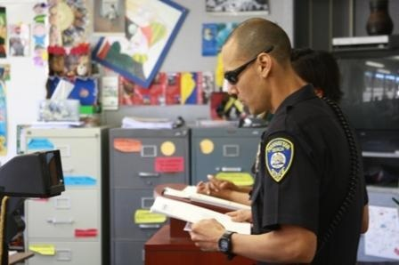 Crime Prevention Officer Mark Vasquez reads a mock-obituary written by the deceased students