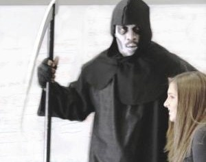 The grim reaper leads a student out of the classroom every 15 minutes