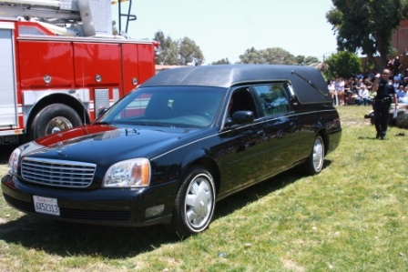 Hearse arrives to take the mock deceased to the mortuary