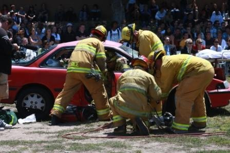 Firefighters begin using the jaws of life to extract the mock victims
