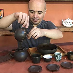 Jesús Chaidez, local tea expert pouring tea