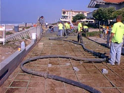 Deliver concrete through hoses to the Strand