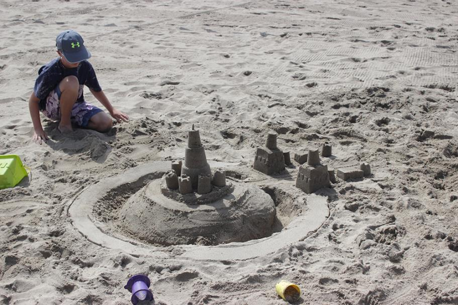 Contestant working on their sand castle