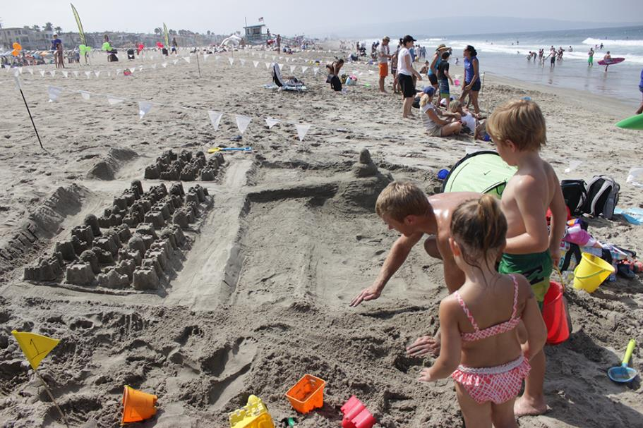 Contestants working on their sand castle