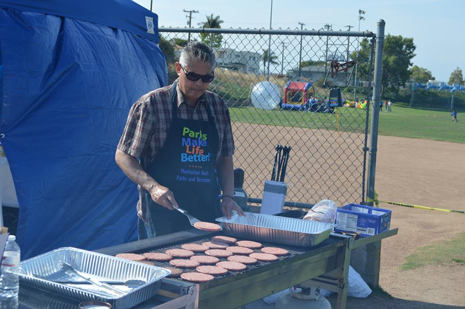 Recreation Services Manager, Idris Al-Oboudi Grilling Burgers for the Campers