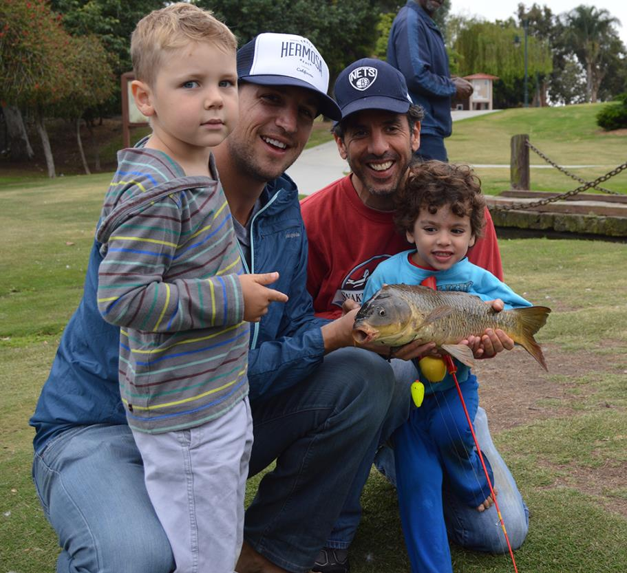 Participants with their catch during the 2015 Fishing Derby
