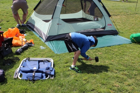 Working hard to set up a tent!