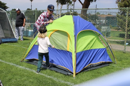 Families setting up their tents
