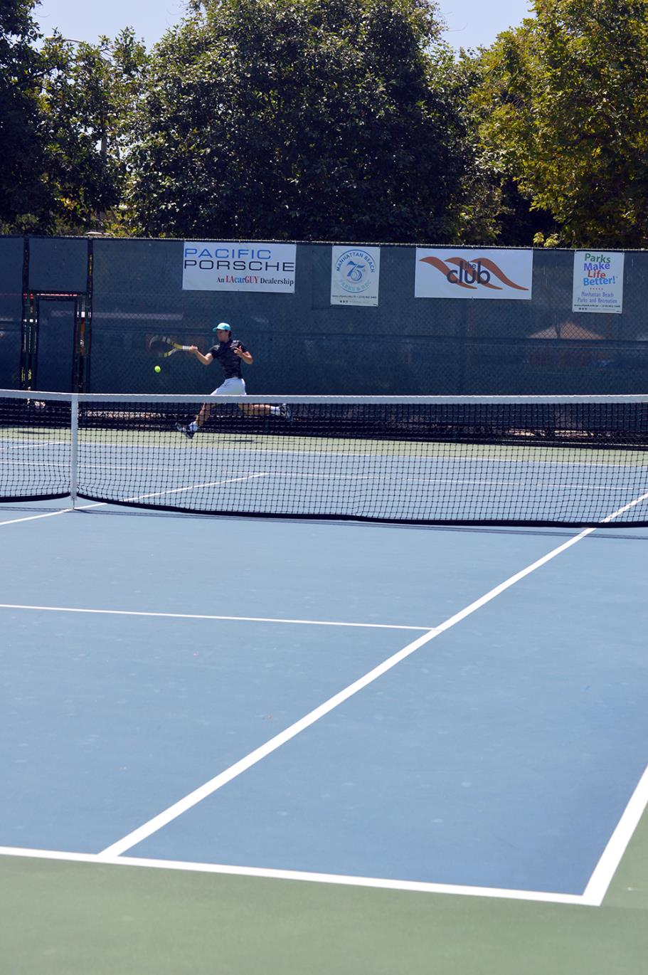Player returning the ball at Live Oak Park Tennis Courts