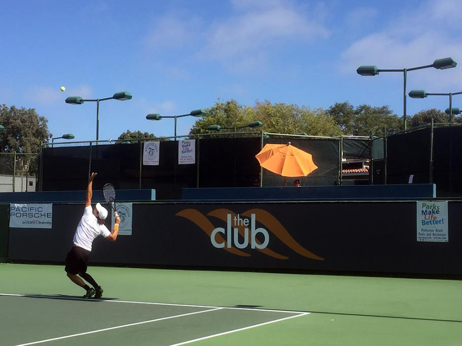 Player serving during the finals at the Manhattan Country Club