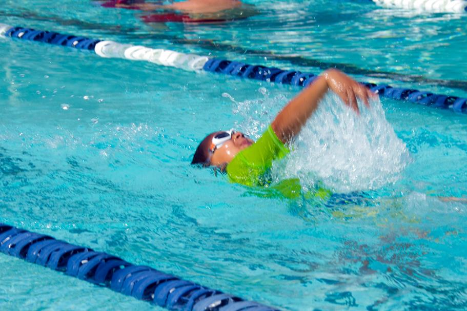 Boy doing backstroke during swim lesson