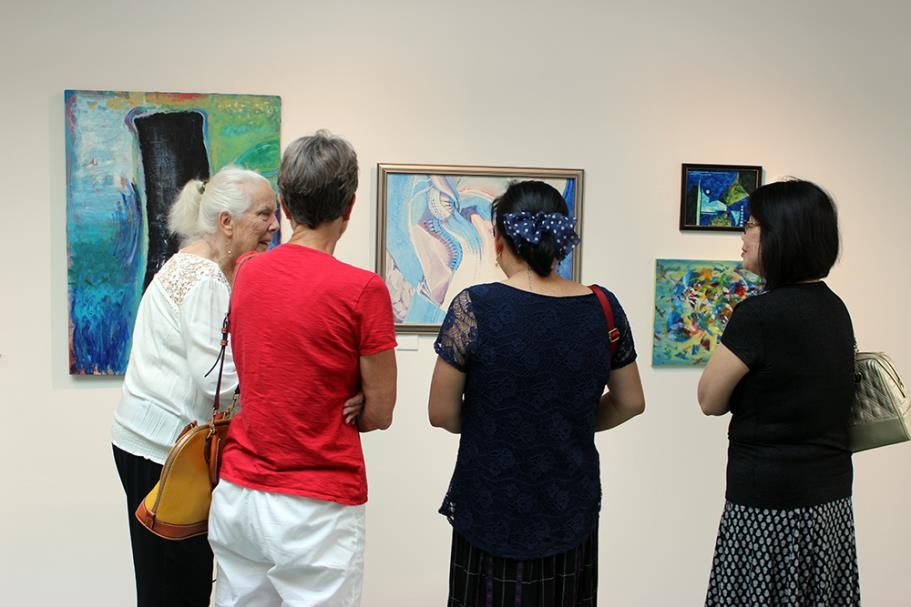 Patrons enjoying the artwork in the gallery