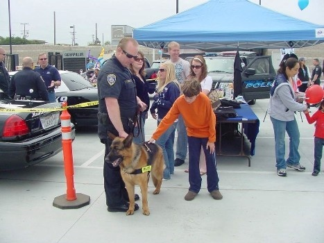 Event attendees meet K-9 Rex and his handler, Officer Zins