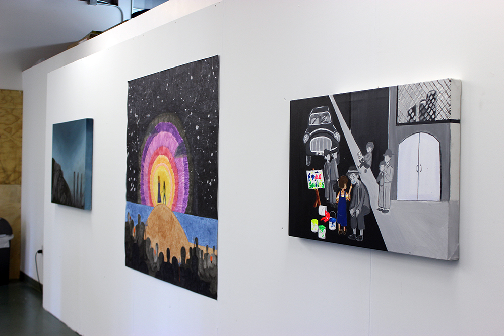 Gallery wall with three artworks