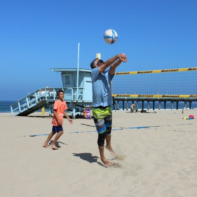 Father and son playing in the annual Father's Day Beach Volleyball Tournament