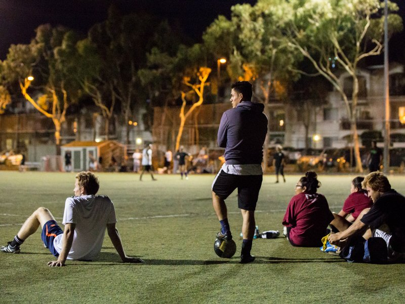 Adult Sports Leagues Website Header - 7 on 7 Soccer players waiting to rotate in