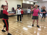 Older adults participating in the Older Adults Program Zumba class