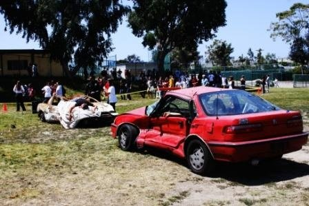 Student begin to assemble at the mock crash site