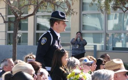 Flower bearers, daughters of manhattan beach officers, present flowers for each of the fallen officers