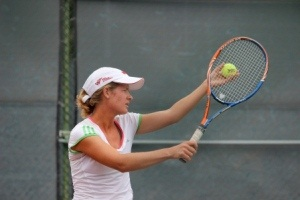Female player getting ready to serve