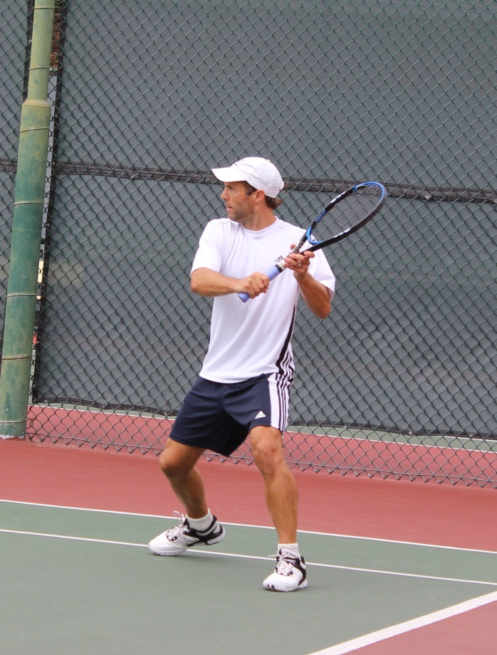 Male player returning ball backhand