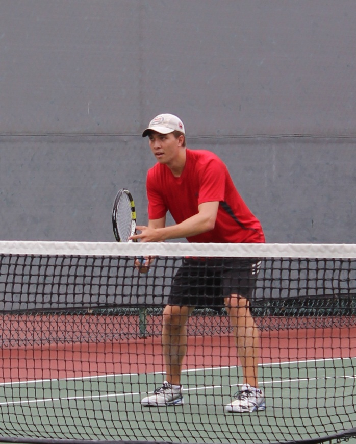 Male player in red shirt ready at net