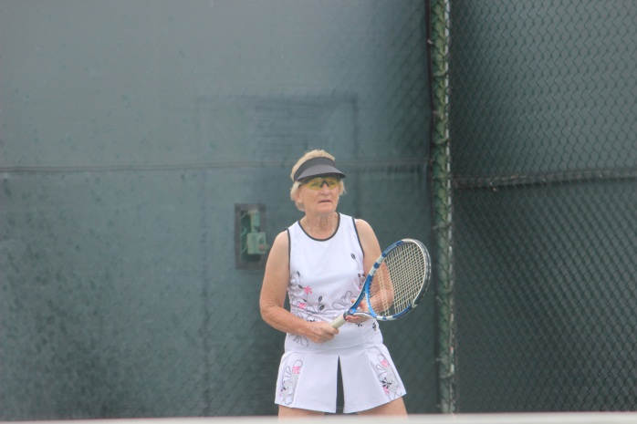 Female player waiting to receive serve