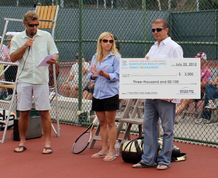 Bennet Slusarz, Jessica Vincent, and Gary Premeaux (South Bay Ford Title Sponsor) getting ready to present grand prize check