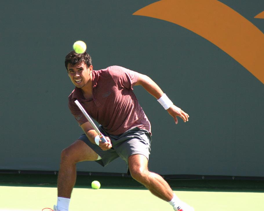 Andrew Dome returning a ball in play the 2014 Manhattan Beach Open Tennis Tournament Mens Open Singles Final