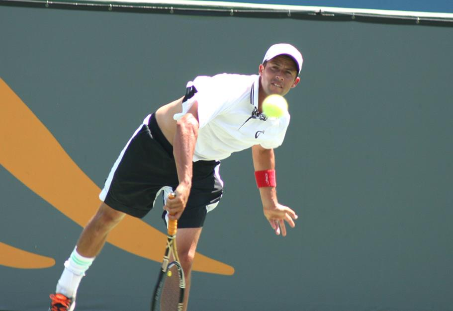 Lester Cook serving to Andrew Dome during the 2014 Manhattan Beach Open Tennis Tournament Mens Open Singles Final