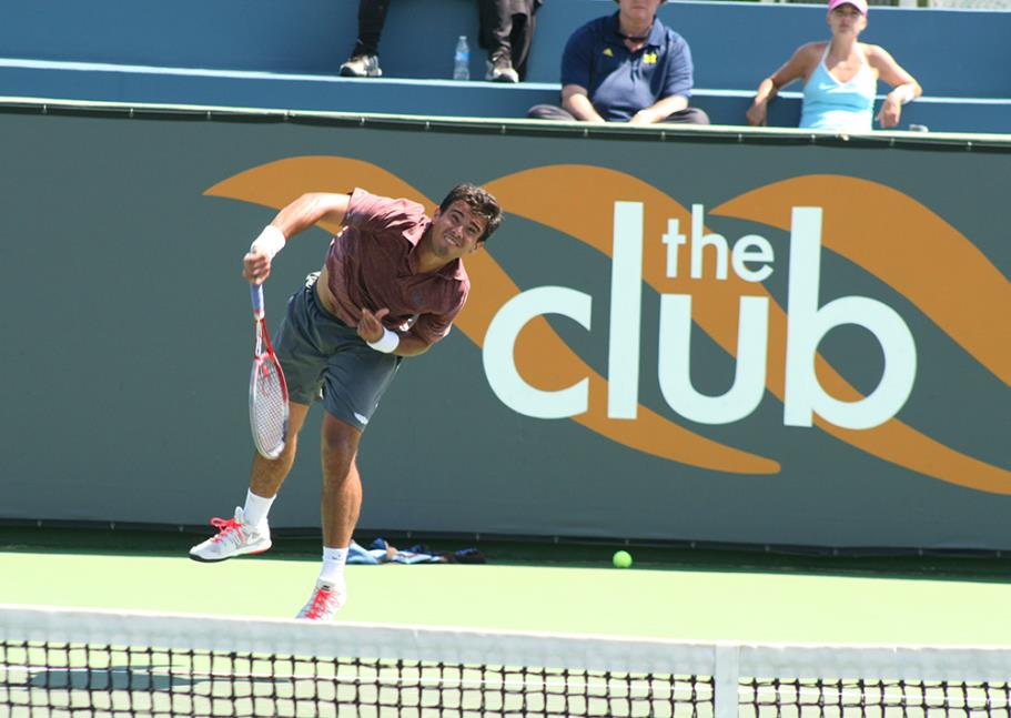 Andrew Dome to Lester Cook serving during the 2014 Manhattan Beach Open Tennis Tournament Mens Open Singles Final
