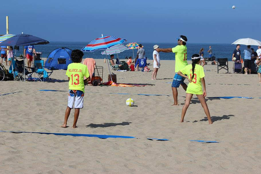 Teams warming up during the 2015 Father's Day Beach Volleyball Tournament