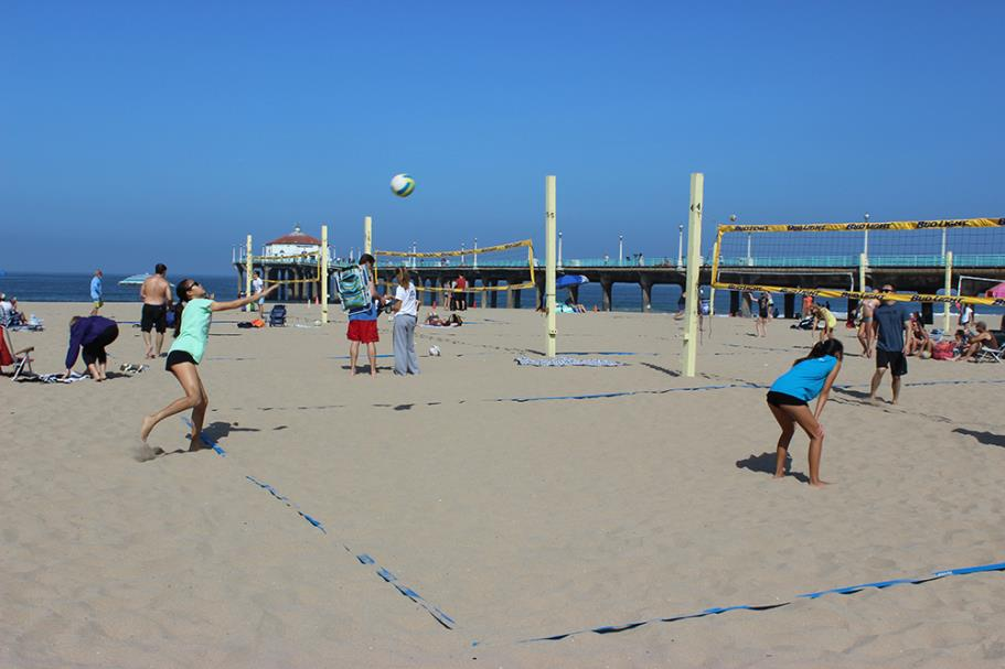 Player serving the ball 2015 Father's Day Beach Volleyball Tournament