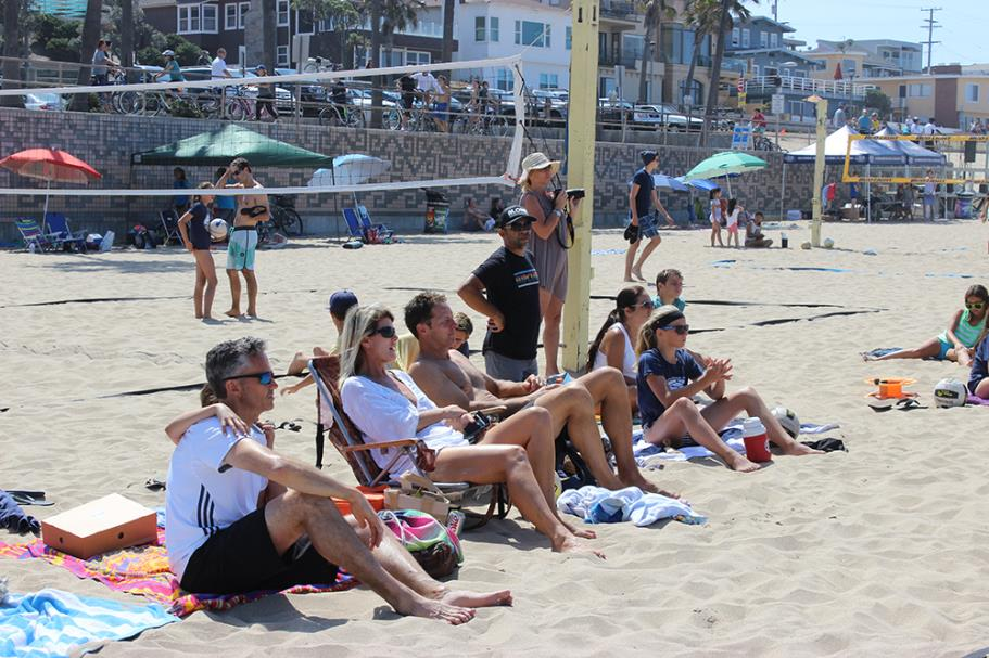 Spectators watching the 2015 Father's Day Beach Volleyball Tournament