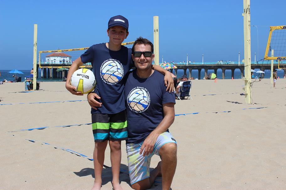 Players wearing the 2015 Father's Day Beach Volleyball Tournament T-Shirt