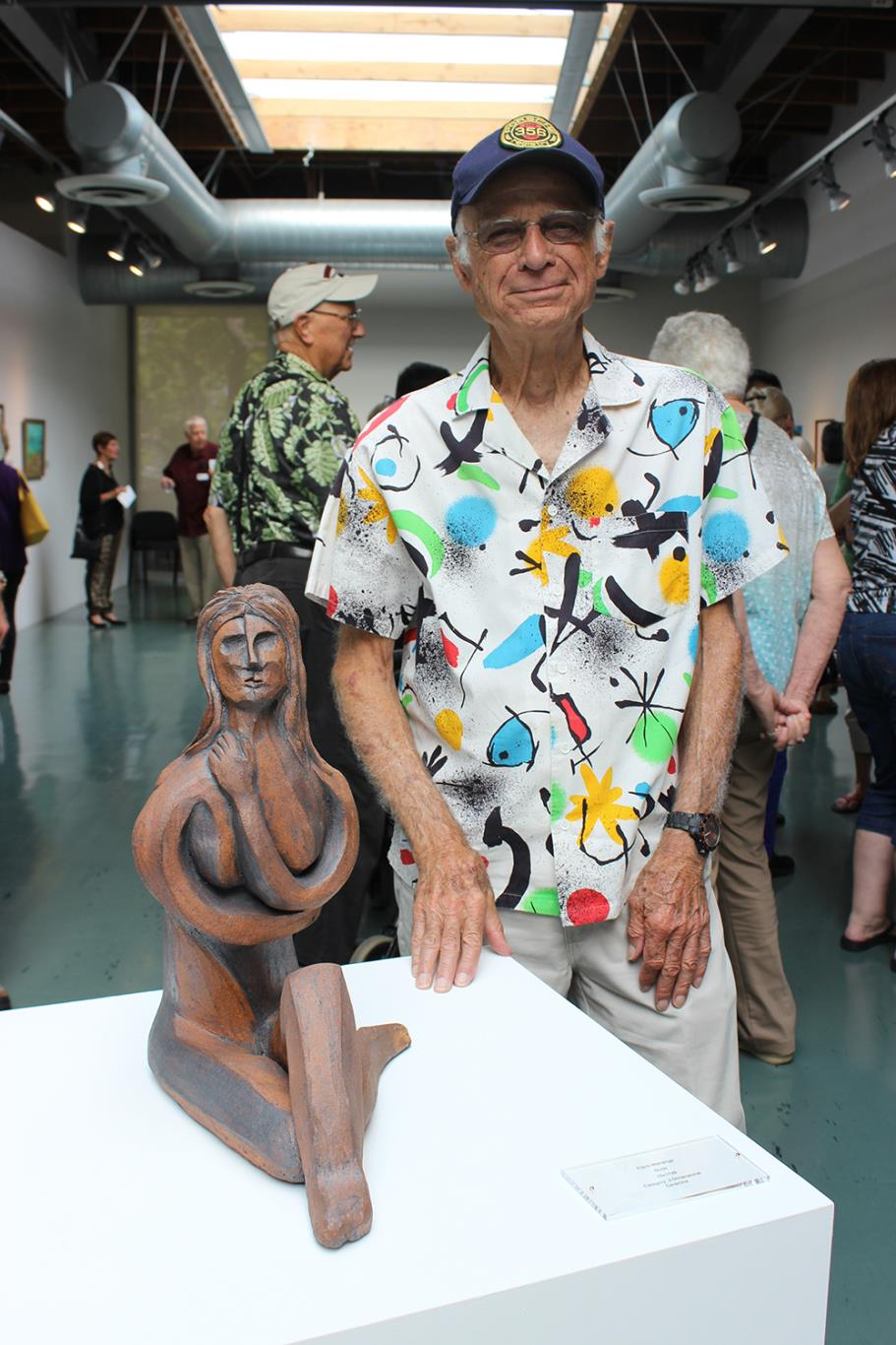 "FIrst place winner Frank Matranga posing with his 3 Dimensional Ceramic piece, ""Nude."""