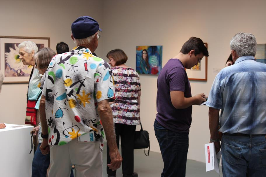 Guests enjoying the art exhibtion